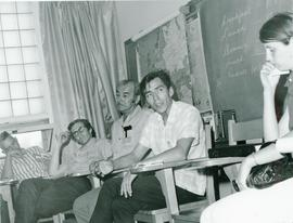 George Munroe and others in discussion