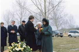 Heidi receiving a flower from the bouquet on Mary's coffin, 1998