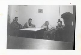 Men sitting at a table at the Rhineland Agricultural Institute