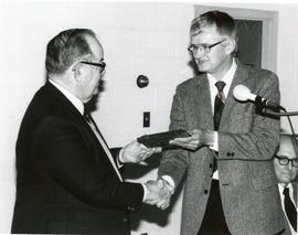 William Snyder receiving recognition at an annual meeting