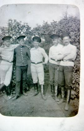 A group of 5 men at the Anadol forestry camp in Russia