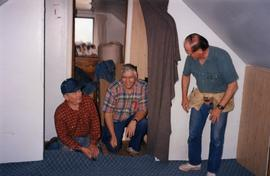 Henry, Neill, and John lay a new carpet, Matheson Island