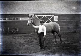 A man from 42.4 with horse.