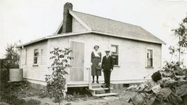 Mary and Peter in front of their first house, at 286 Mckay