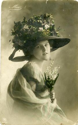 Young woman in flowery hat