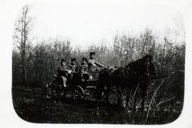 Forestry men riding in a Droschke