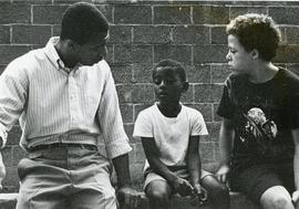 Brian Fountain talking with two youth