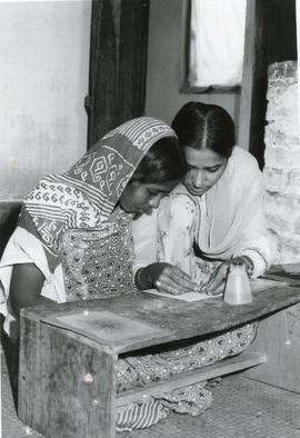 Two women crafting gift cards in Bangladesh