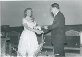 Heidi receiving her high school diploma