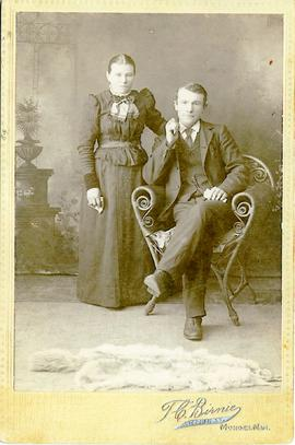 Unidentified man and woman posing for a photo