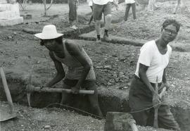 Digging trenches for the foundation of a boys' school