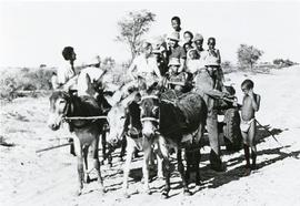 The Ewerts riding with a donkey cart in Botswana