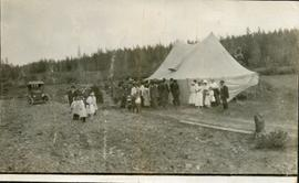 Congregation outside a large tent