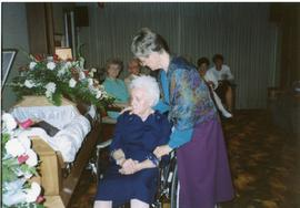 Heidi bringing Mary in a wheel chair to Peter's coffin, 1990