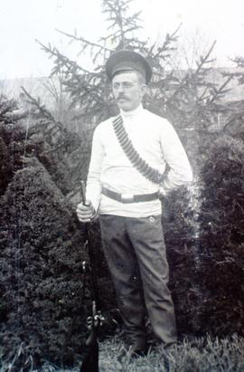 A Mr. Bergman (or Barkman), likely serving as forest watchman with a gun