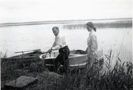 Peter & Edith tying  up a boat on a lake