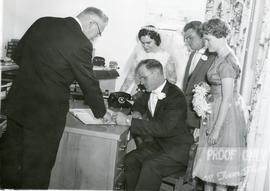 Alfred signing the marriage license