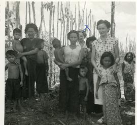 Helena Reimer and [Dr. Danvoye] in the Cambodian countryside with mothers and children
