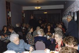People having food after the funeral, 1998