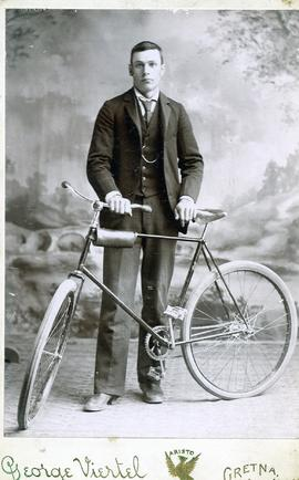 Abram S. Rempel  with his bike