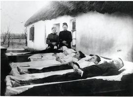 Jakob Enns and daughters, and Miss Kremser funeral