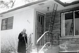Mary sweeping steps in front of 231 Edison Ave, 1970