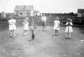 Kids playing croquet