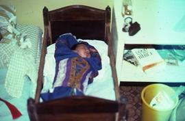 Baby in indigenous cradle, crib