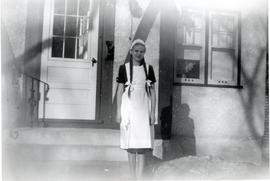 Heidi in front of house at 75 Hart Ave, 1953