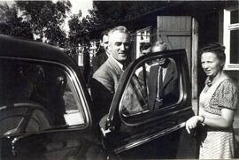 C.F. Klassen getting out of a car