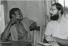 Joseph Dabonebda talking with Elroy Holsopple (Uganda)