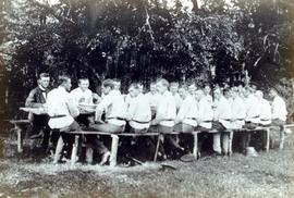 Group of men in forestry service eating outside