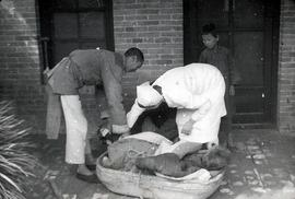 Cholera patient brought in a basket