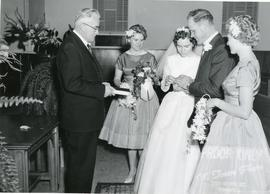 Edith placing his wedding band on Alfred's finger