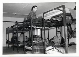 Young men on bunk beds at the Rhineland Agricultural Institute