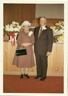 A woman and a man, at North Kildonan Mennonite Brethren Church
