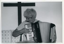 Trudie playing accordion
