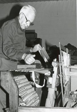 Allen Martin operating the loom for rug-making