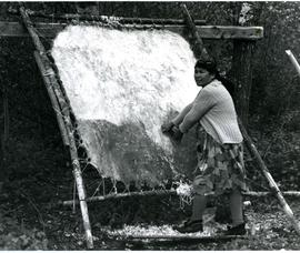 Madeline Owen scraping moose hide