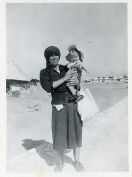 Refugee Woman holding a baby in refugee camp, Egypt.