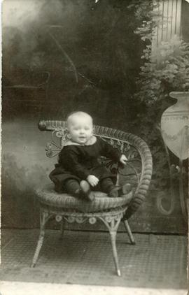 Child sitting on a chair