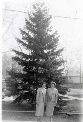 Edith, & Heidi outside by a tree, 1958