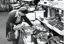 A woman shops at New Holland Thrift Shop