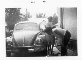 Mary and Edith cleaning the car