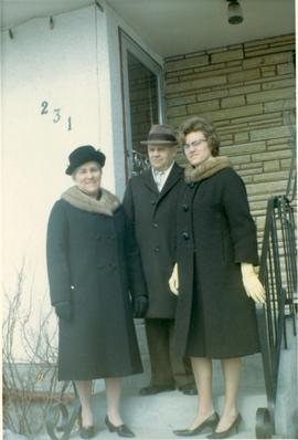 Mary, Peter, Heidi on front steps