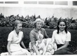 Heidi, Edith  and a friend sitting on the grass