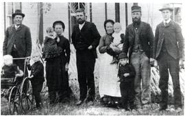A close-up of Harms family beside the house in Winkler