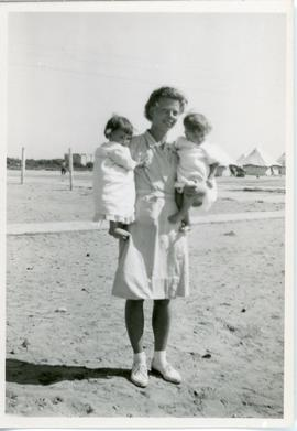 Nurse holding two babies refugee camp, Egypt