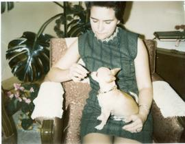 Edith feeding Poncho on her lap, Dec 1970