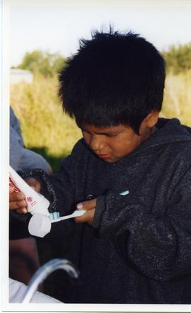 Boy brushing teeth, Matheson Island